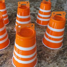"""Construction Cones Craft This construction cone craft will get miles and miles of use. Whether your little worker uses them as a prop for pretend play or bowls them over in a rousing game of """"deconstruction bowling"""" these cones are realistic looking and easy to make."""