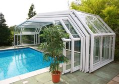Retractable pool enclosure to cover pool when not in use; keeps the water warm with a heater.