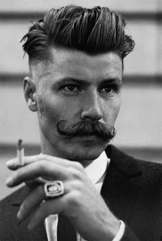 men undercut hairstyle and handlebar mustache.