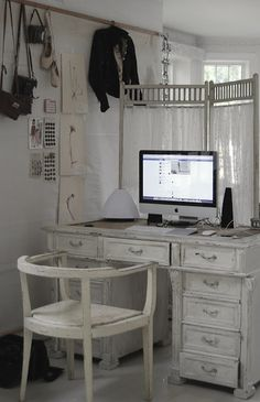 Small home office idea. Screen off an area in the family room to be your work space.