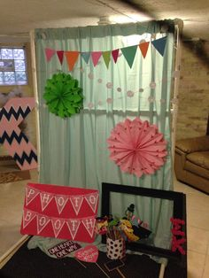 DIY photobooth for under $50:  PVC pipe for the frame, full bed sheet for the backdrop, pinwheels and garland to add a pop of color, and lots of fun props!