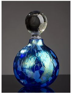 Ship in 2-3 weeks Iridescentcobalt in its truest form,blowninto a round perfume shape. Dimensions:3.5″H,2″diameter About the Artist:Bryce Dimitruk