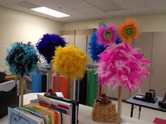 styrofoam ball on plunger with a boa glued to the ball, love it! I'd like them taller though...hmm