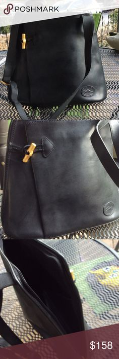 Longchamp 1948 gorgeous genuine leather bag Opens on side all the way to top.vary good condition.Two pouches inside and one pocket on front.Like new Longchamp Bags Shoulder Bags