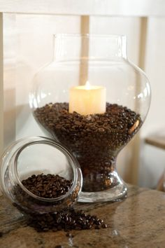 Coffee beans and vanilla candles...instant heavenly aroma!~I am going to try this for Sure~!~ Lovely Idea~!~If you are a Real ~Coffee Lover~ that is~ I make my Morning Coffee with a ~French Press~ So I have plenty of Coffee beans around~ And The ~Vanilla~ Candle is Wonderful~ Just have to go out & buy a Glass Vase~;)