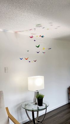 Clear Colored Origami Paper Crane Mobile. Birds are folded from clear colored acrylic sheets. It's handmade with care and makes a colorful addition to any room, whether an office, a newborn nursery, or any space that needs a little whimsical decor. #artmobile #nurserydecor #nurseryinspiration #nurseryinspo #origamimobile #babymobile #nurserymobile #officeart baby room, office art, baby shower gift, travel decor, nursery ideas, crib mobile, nursery decoration, kinetic art, art mobile, baby…