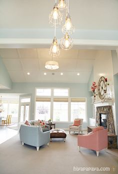 House of Turquoise: Four Chairs Furniture + Hiya Papaya -  I would love that clock over the mantle for my tv room