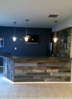 Stikwood Reclaimed Weathered Wood I'm in love!! Maybe grey or red wall color