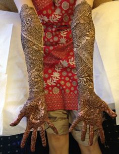Intricate bridal henna above the elbows front and back
