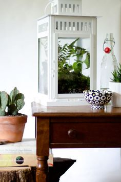 Potting soil, charcoal, gravel, and plants fill the lantern with an earthy brightness. The result is both decorative and low maintenance. Click for more IKEA transformations that will blow your mind!