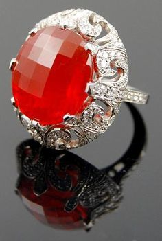 Look at the framing on this ring! Fire opal 10.18 ct. Diamonds 1.09 tcw. Platinum. Undated but presumed to be antique/vintage