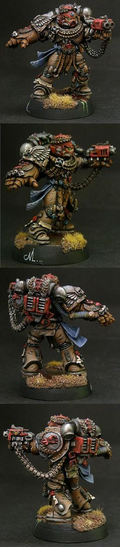 Warhammer 40k, Space Marines. Awesome paint/modeling job on the Crimson Fists Chapter Master, Pedro Kantor. Not sure about the color scheme, but it looks amazing