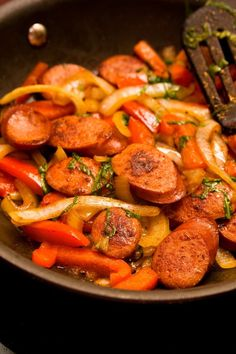 Recipe including course(s): Entrée; and ingredients: chicken broth, dried oregano, garlic, green bell pepper, onion, red bell pepper, red pepper flakes, turkey sausage, yellow bell pepper