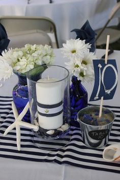 Good Images Of Blue And White Centerpieces For Wedding Table Decoration Ideas : Contempo Nautical Flower Blue And White Centerpieces Including Blue Stripe Wedding Table Cloth Including Round Glass Flower Vase For White Wedding Design And Decoration Ideas