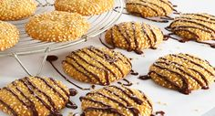Toasted Sesame Seed Sugar Cookies: To a simple sugar cookie, add nutty crunch with toasted sesame seed and an extravagant touch with a bittersweet chocolate drizzle. My Recipes, Cookie Recipes, Dessert Recipes, Favorite Recipes, Chocolate Chunk Cookies, Chocolate Drizzle, Baking Chocolate, Easy Sugar Cookies, Sesame Cookies