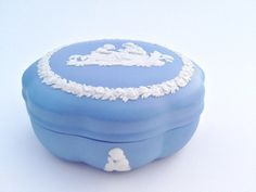 Wedgewood Blue White Jasperware Porcelain Trinket or Jewelry Box! Beautiful piece for any room in the house! It has a picture of a mother and child sewing.Dimensions: Width 5 inches Height 2 1/4 inchesKeep in mind this is a vintage item it will have imperfections.  No cracks or chips to the naked eye.