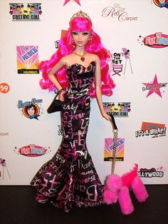 Tarina Tarantino Arriving    		Wearing Silkstone 45th Anniversary ensemble.  With her Randall Craig  Poodle M