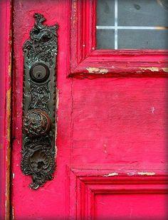 Bright doors and intricate doorknobs.