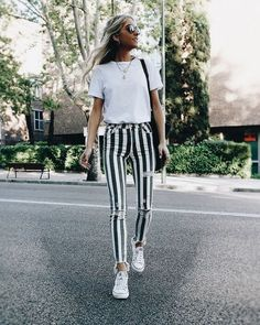 styling white tee, white tee style, summer style, street style, street style 2018, styling statement pants, styling stripes, striped jeans, styling stripe pants, white sneakers, styling white sneakers