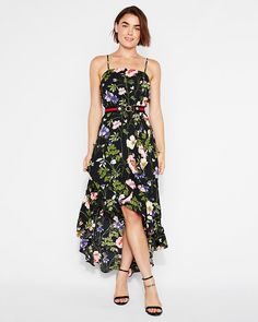 9c22c586 This floral maxi dress features ruffles, an elastic waist and adjustable  straps for simply sexy style. Made with lightweight floral fabric, ...
