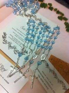 36 pcs  First communion favors / Mini  Rosary Baptism Favors / Baptism favors / Religious Mini Rosary / blue rosaries /  Narelo by NARELO on Etsy https://www.etsy.com/listing/197349155/36-pcs-first-communion-favors-mini