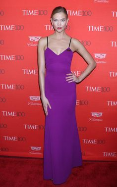 US beauty and entrepeneurKarlie Kloss framed her lithe physique in punchy purple Victoria Beckham