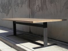 oak dining table with iron base | from mcm house