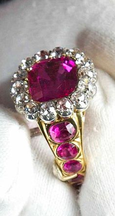 British Crown Jewels:  The Queen Consort's ring set with a large ruby, weighs 50.15 carats. The large ruby is surrounded by 14 round brilliant diamonds and set with rubies on the yellow gold shank. The ring was originally made in 1831 for Queen Adelaide at the coronation of her husband in 1831.