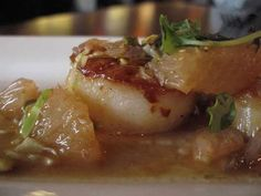 Seared scallops with grapefruit is an appetizer at the Root in White Lake.