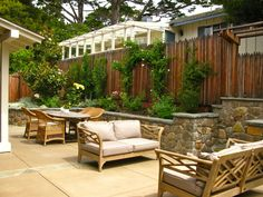 stone retaining wall with cap, short columns Retaining Wall Fence, Carmel By The Sea, Outdoor Spaces, Outdoor Decor, Sofa Seats, Backyard, Patio, Stone Work, Hedges