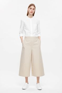COS image 6 of Wide-leg cotton trousers in Biscuit