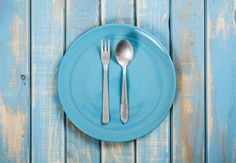 #Blue empty plate  Blue empty plate with fork and spoon