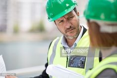 Stock Photo : Manager and foreman discussing construction project on site