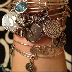 Alex and Ani bracelets ... Every girl would get a unique charm picked out by Jess!
