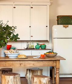 Rustic wood and white kitchen with vintage touches.  Photo by Lisa Romerein/OTTO