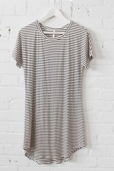 - Black and white striped t-shirt dress - Loose fit - Short sleeves - Round neckline - Soft and stretchy classic jersey knit material - Can be worn as a dress or a top paired with leggings/jeans! - 60