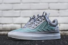 Rocking arrow tilted chevrons, the latest Filling Pieces Low Top brings to mind Hummel's branding. The sneaker comes planted on a white sole that supports