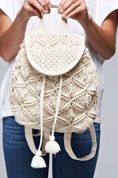 Hand crochet mini backpack with tassel closure and adjustable straps.