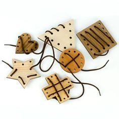 Lacing Toy This Maple, Cherry and Walnut Lacing Toy helps children develop fine motor skills and shape recognition. The six piece set includes