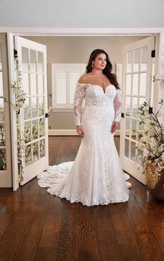 PLUS-SIZE FIT-AND-FLARE WEDDING DRESS WITH LONG SLEEVES Plus Size Wedding Gowns, Essense Of Australia, Wear Store, Fit And Flare Wedding Dress, Bridal And Formal, Long Sleeve Wedding, Designer Wedding Dresses, Formal Wear, Bridal Gowns