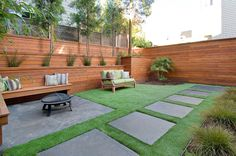 Contemporary Landscape with Hide Chain Link Fence Design by Rico's General Construction Inc. brings together the critical elements of art and science to make a functional,…