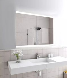 LED bathroom mirrors are the perfect way to avoid a poorly lit bathroom. Why? Just look at this. The LED frame immediately adds a bright and airy atmosphere. This particular LED mirror also has speakers built in! Backlit Bathroom Mirror, Bathroom Mirror Design, Bathroom Mirror Cabinet, Led Mirror, Mirror Cabinets, Mirror With Lights, Bathroom Interior Design, Bathroom Ideas, Downstairs Bathroom