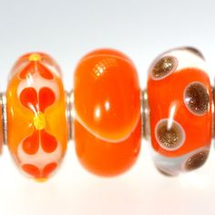 Trollbeads Gallery - Twins & Trios - Just Listed!  Orange is the HOT color this year!  http://www.trollbeadsgallery.com/twins-trios-238/