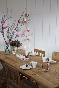 wooden diner table and handmade decorations. waste your time to make some paper flowers for your happy meal.