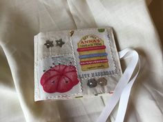 Items similar to Ooak Appliqued needle case with lace and embellishments, Needlebook, Sewing, Fabric. on Etsy Needle Case, Needle Book, Embellishments, Applique, Embroidery, Unique Jewelry, Handmade Gifts, Tableware, Lace