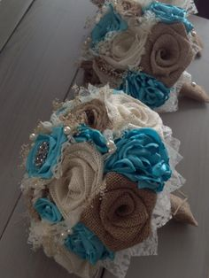 Handmade bridal bouquets with natural and ivory burlap and tiffany blue silk flowers by BurlapandLacePlace on Etsy https://www.etsy.com/listing/213130492/handmade-bridal-bouquets-with-natural