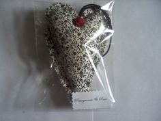 Medium hanging heart fragranced with pomegranate and pear and embellished with a small, red, paper rose.