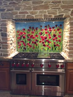 """We created this unique """"red poppy"""" motif mural for our client in Pennsylvania. The mural is 34"""" x 52"""" and is created in four panels that were adhered to the kitchen backsplash using thinset."""