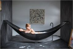 "The Vessel is bath tub that hangs like a hammock! The tub is crafted in carbon fiber making it light enough to hang suspended above the ground and features a foam core insulating the tub and keeping the water warm. It fits two people and is the perfect ""vehicle"" for total escapism"