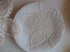 Handmade pottery plate with doily impression